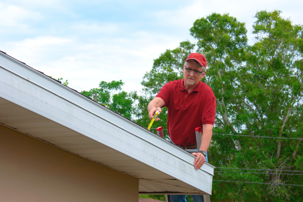 Home inspector checking the roof of a house