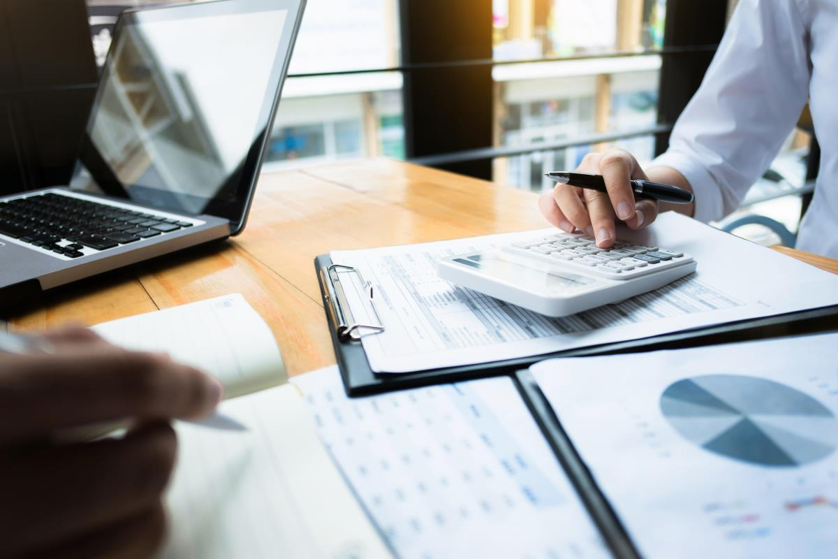 Business owner calculating budget