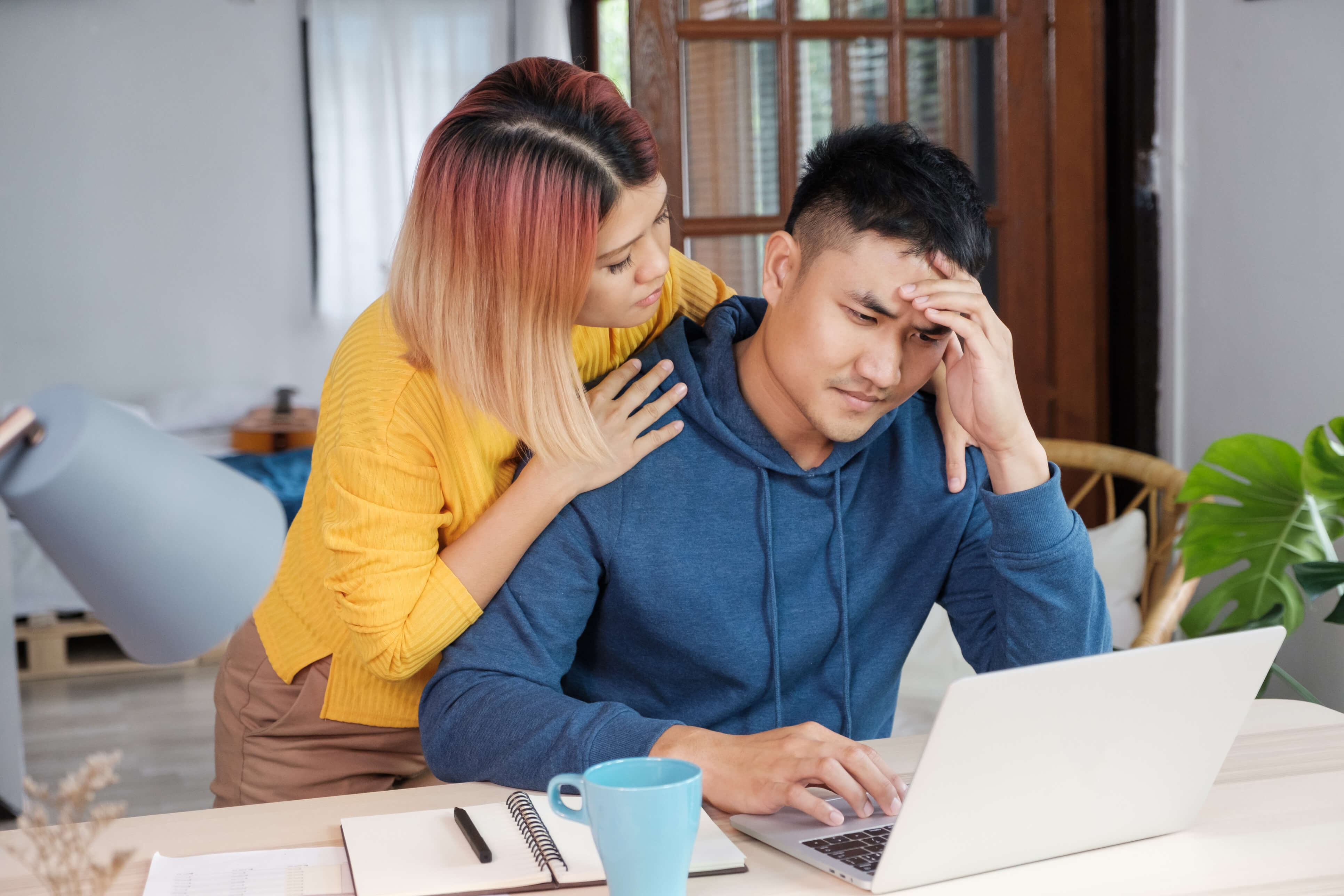 Wife consoling husband after identity theft incident