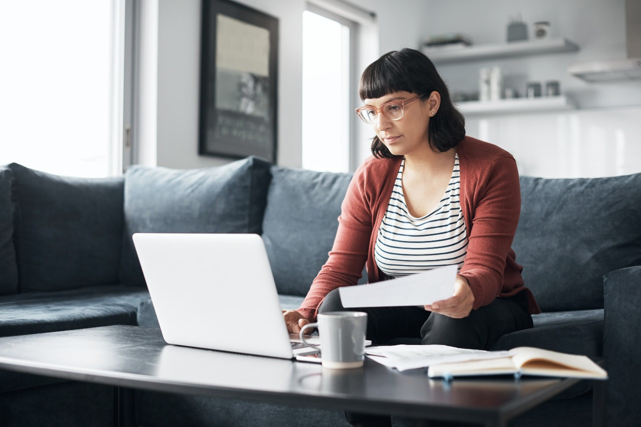 Woman using her laptop to create a budget