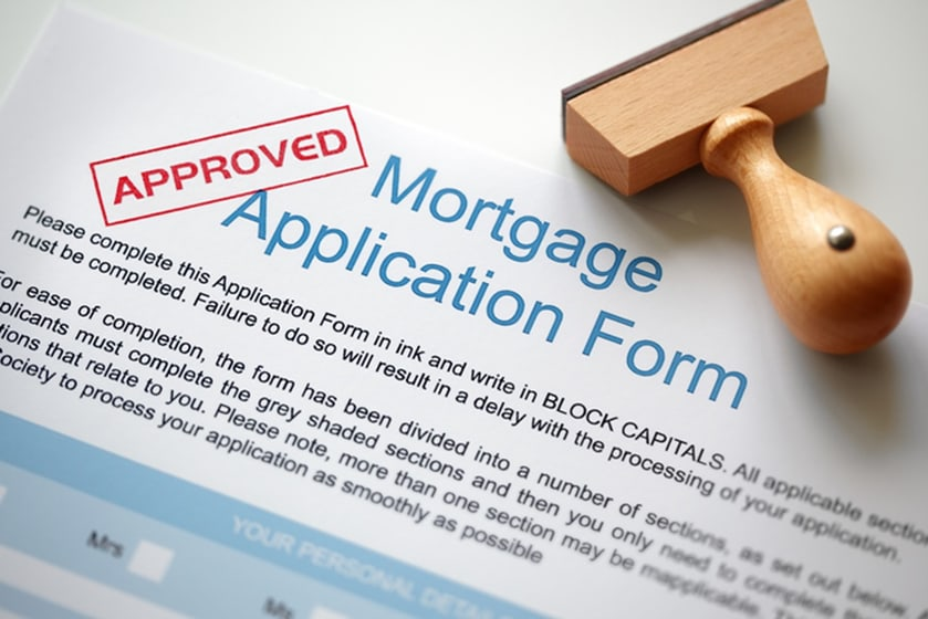 Mortgage Application form with an approval stamp
