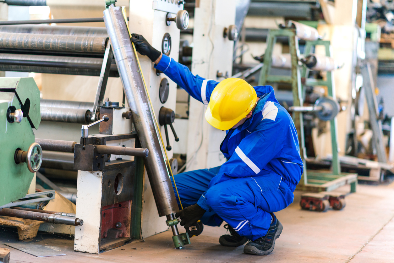 Worker operating heavy equipment