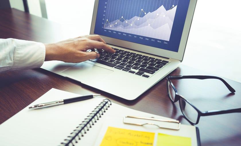 Laptop computer displaying chart