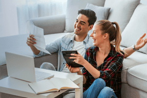 Couple researching whether they can refinance during COVID-19